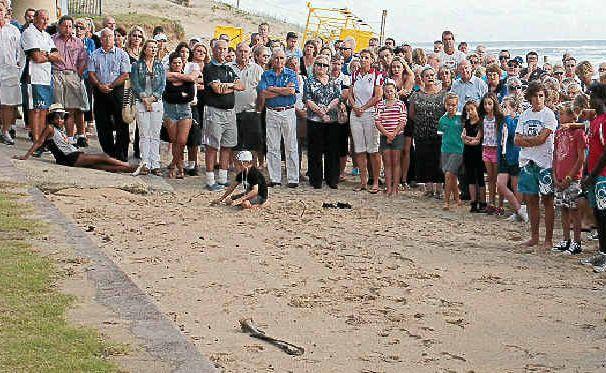 Friends of Matt Barclay hold a memorial service at the Maroochydore Surf Life Saving Club.