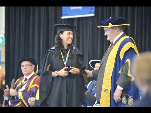 Jennifer Rees Brown receives her University Medal from Chancellor, The Honourable John Robert Arthur Dowd, AO QC.