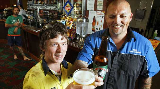 Rohan Harper, Shane Carter, and Craig Morrow – holding up the bar – are some of the first to try the great range of new beers available at the Yamanto Tavern.