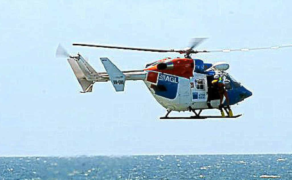 The AGL helicopter pilot and crewman, along with lifesavers and a police motor launch, train off Nielson Park Beach.