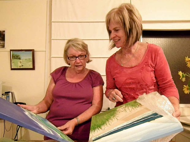 Wooli Artshow committee members Ruth Boyd and Leone Coper unpacking some of the entries.