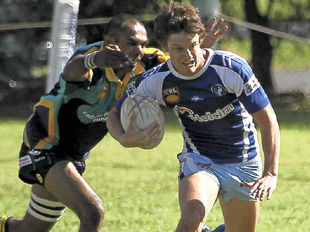 Ghosts' Mitchell Lollback tries to outrun the Evans Head defence in a trial match at McGurren Park.