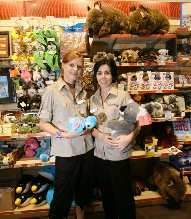 Assistant managers of the new Australian Geographic shop at Stockland Rockhampton, Rachael Bartlett and Ella Schalch, cuddle up to some of the store's furriest products.