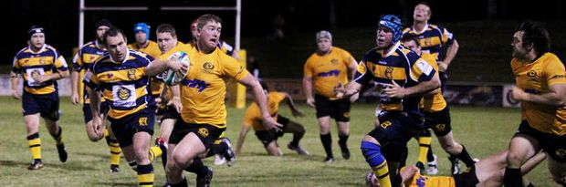 Brahmans hooker Jeff Milburn tucks the ball under his arm and heads for the Central Highlands line at Rugby Park.