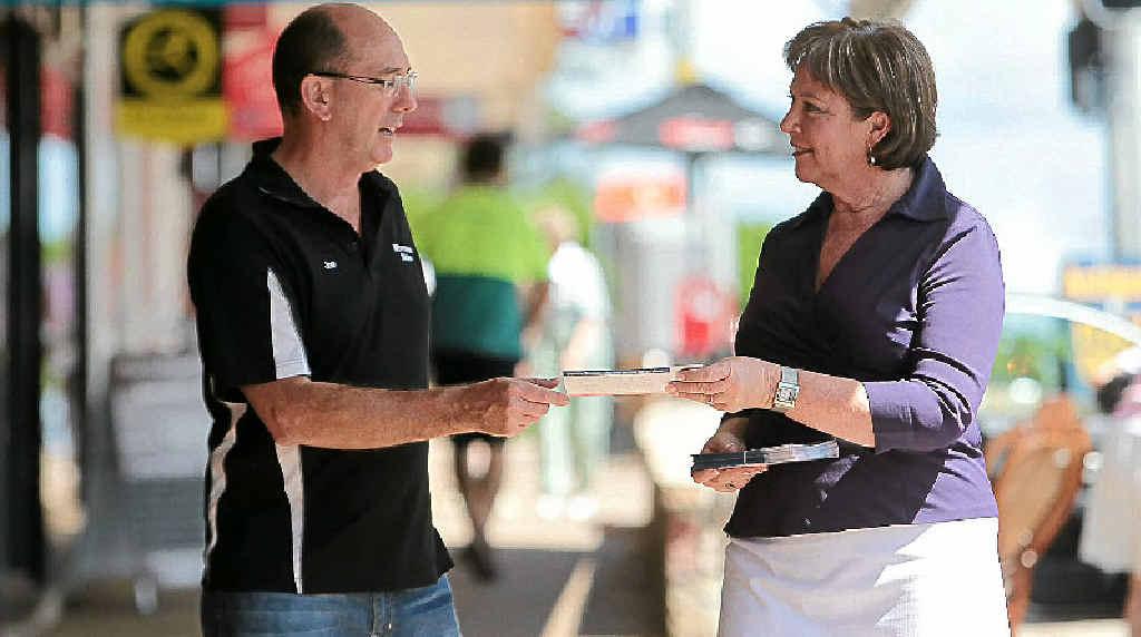 MEET AND GREET: Debbie Blumel campaigns in Buderim, giving a card to Joe McLaughlin.
