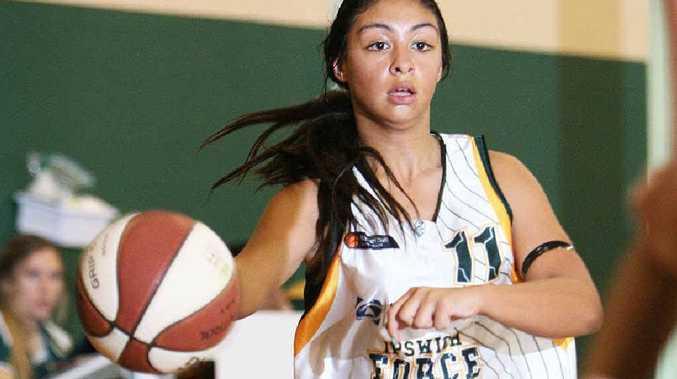 Ipswich under-14 basketballer Jada Schultz displays fine court coverage on her way to scoring 11 points in yesterday's state titles win over South West Metro at Ipswich stadium.