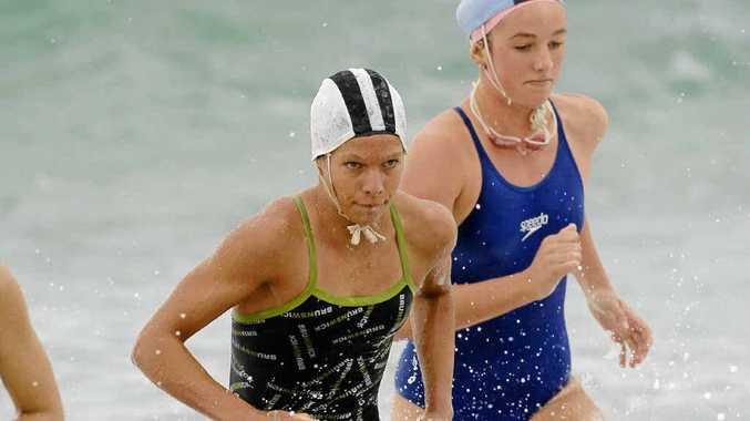 Ela Heiniger, left, won the Under-15 ironwoman event at the Australian championships on the Gold Coast.