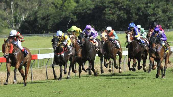 Motoki Okada on the way to riding Top Agenda to victory in the Class 3 handicap (1516m) at the Lismore Turf Club yesterday.