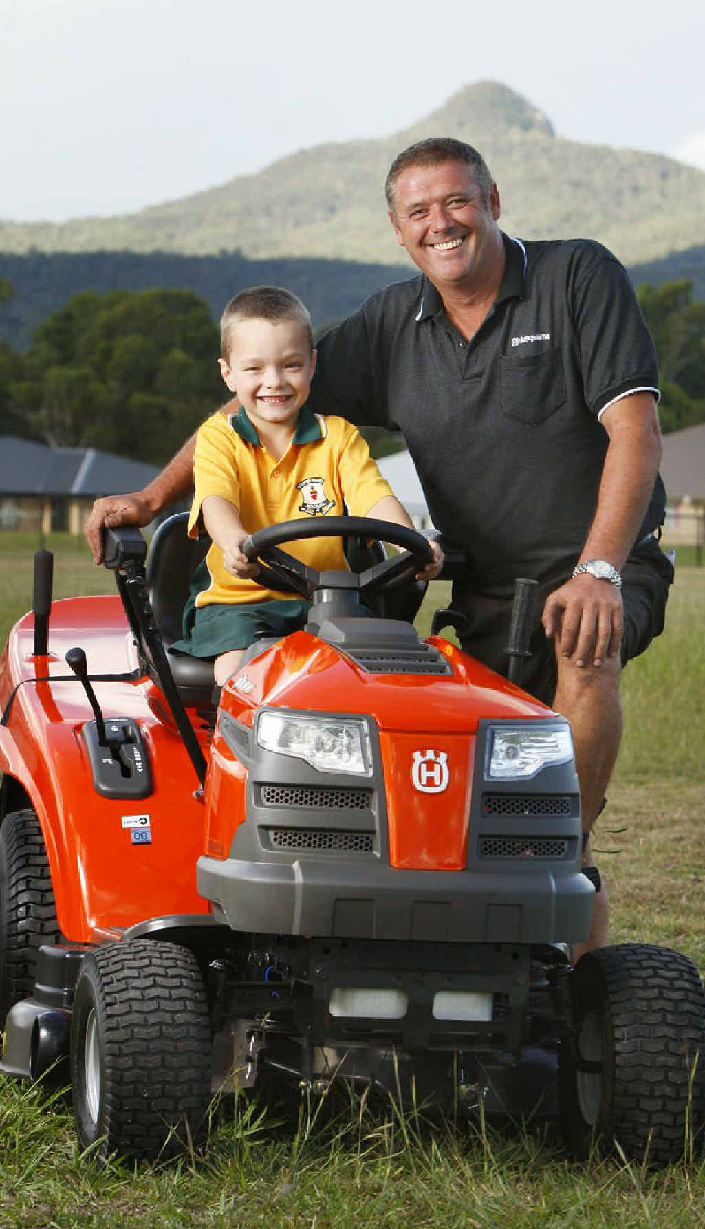 Six-year-old Eithen Leard, of Peak Crossing, is ready to help out at home thanks to the work of Marcus Page from Yamanto Mower and Garden Centre, who adapted a ride on mower so Eithen could use it.