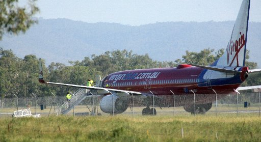 Police were called to a Virgin flight after threats were made about the time of departure from Rockhampton Airport yesterday.