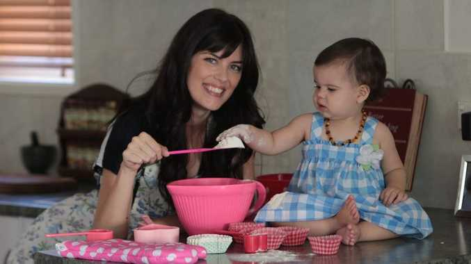 Food blogger Stacey Roberts makes some cup cakes with her baby, Abby (1).