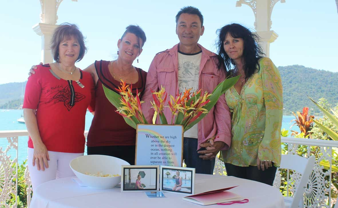 SUPPORTING ONE ANOTHER: Carmel Brooke's friends Maureen Foster and Michelle Black, brother Bill Heang and step-daughter Lisa Brookes gathered to remember her at a memorial on Monday at Coral Sea Resort in Airlie Beach. Photo Aimee Vinci / Whitsunday Times