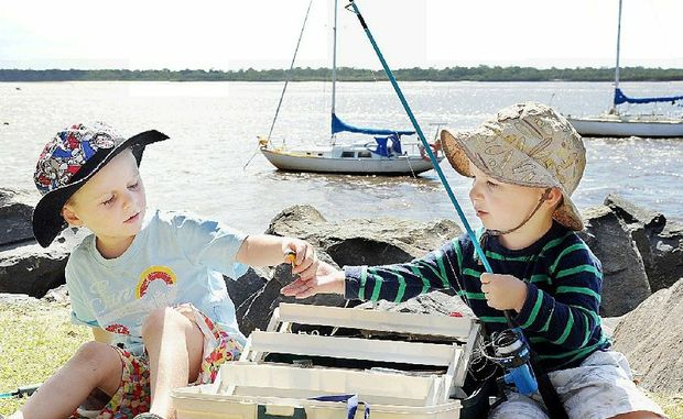 Oliver, 4, and Charlie Geeves, 2, from the Glass House Mountains are rearing to go fishing with their family at the Burrum Heads Easter Fishing Classic.