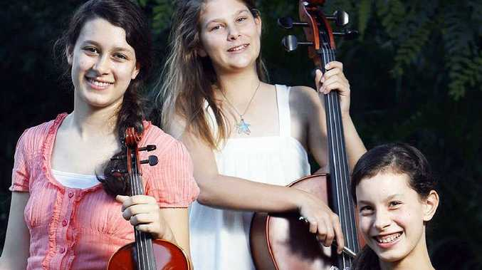 Young Ipswich string musicians Madeleine Ambrey, 15, Alyssa Hawkins, 13, and Elizabeth Cane, 14, with their instruments.