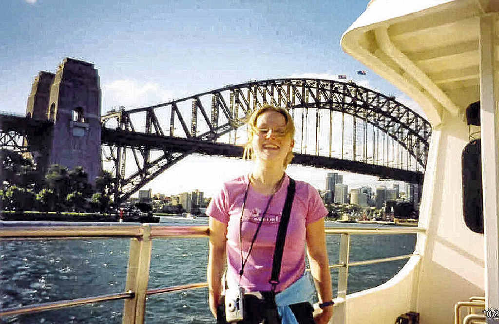The life of Caroline Stuttle, pictured here at Sydney Harbour, will be celebrated at a 10-year anniversary memorial service in Britain after she was killed in Bundaberg in April 2002.