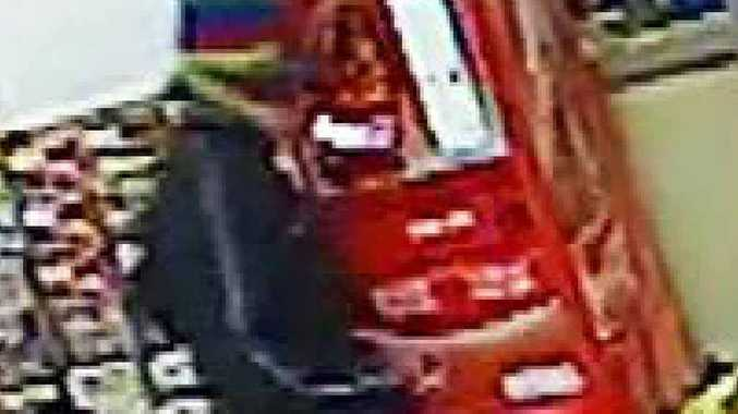 A CCTV image of a man wanted by police following two robberies.