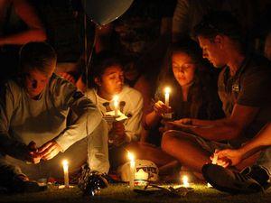 Teens remembered at vigil