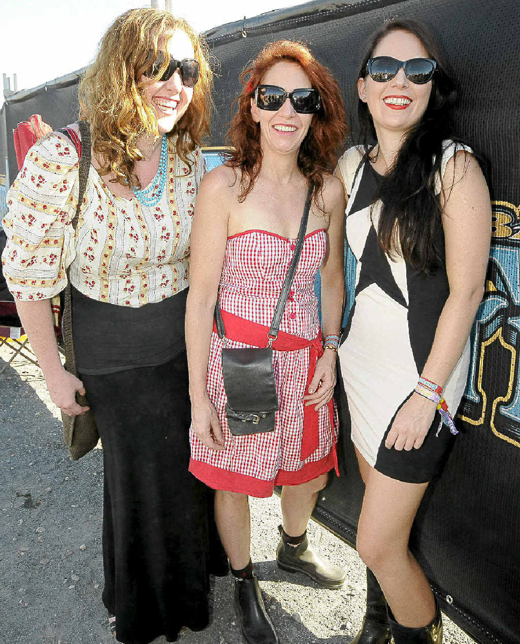Brisbanites Laura Taylor, Edwina Luck and Zoe White joined the unofficial fashion parade at Bluesfest.