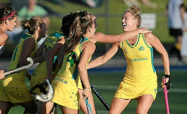 Australia's Emily Hurtz celebrates with teammates after opening the scoring at Buderim yesterday against the USA.