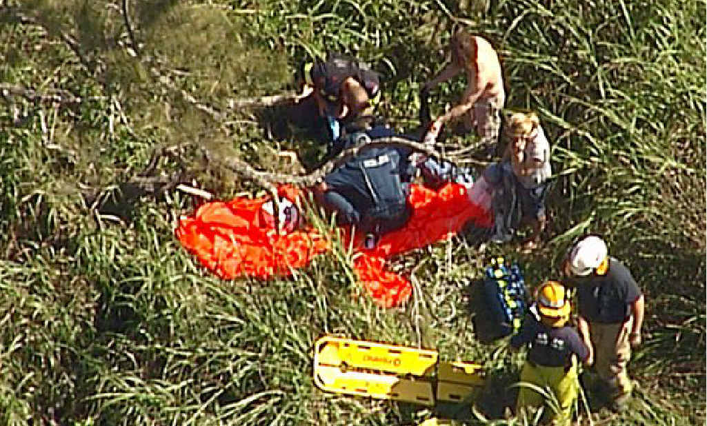 Emergency crews attend to a man who was injured while skydiving at the weekend.