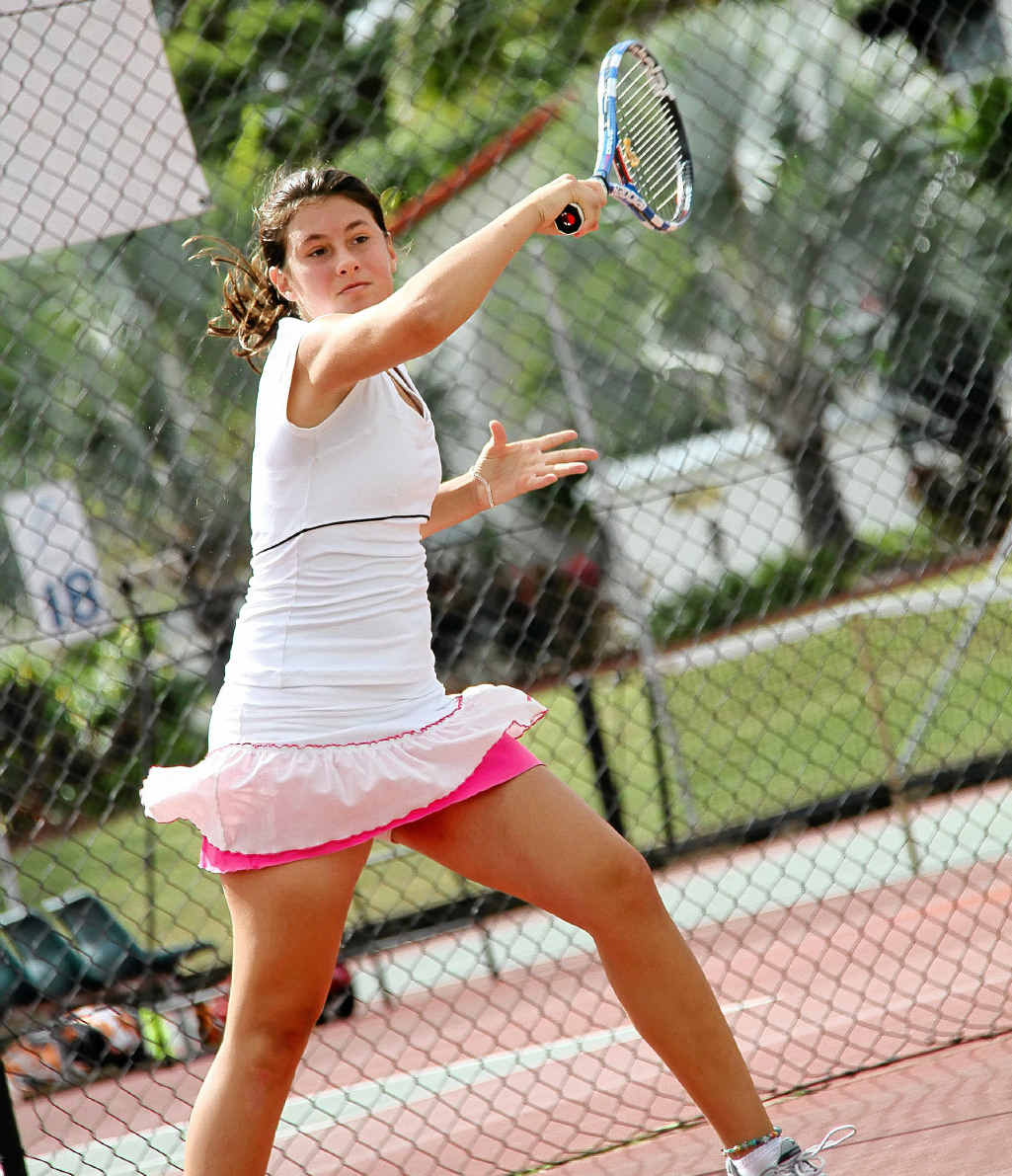 Sarah Tomic competes in the Gladstone Hardcourt Championships last year, showing the style that won her a national title on the weekend.