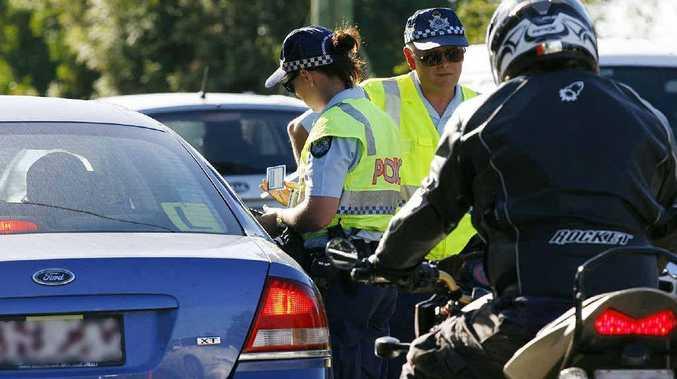 Police conduct random breath testing on the Brisbane Valley Hwy outside Fernvale State School.