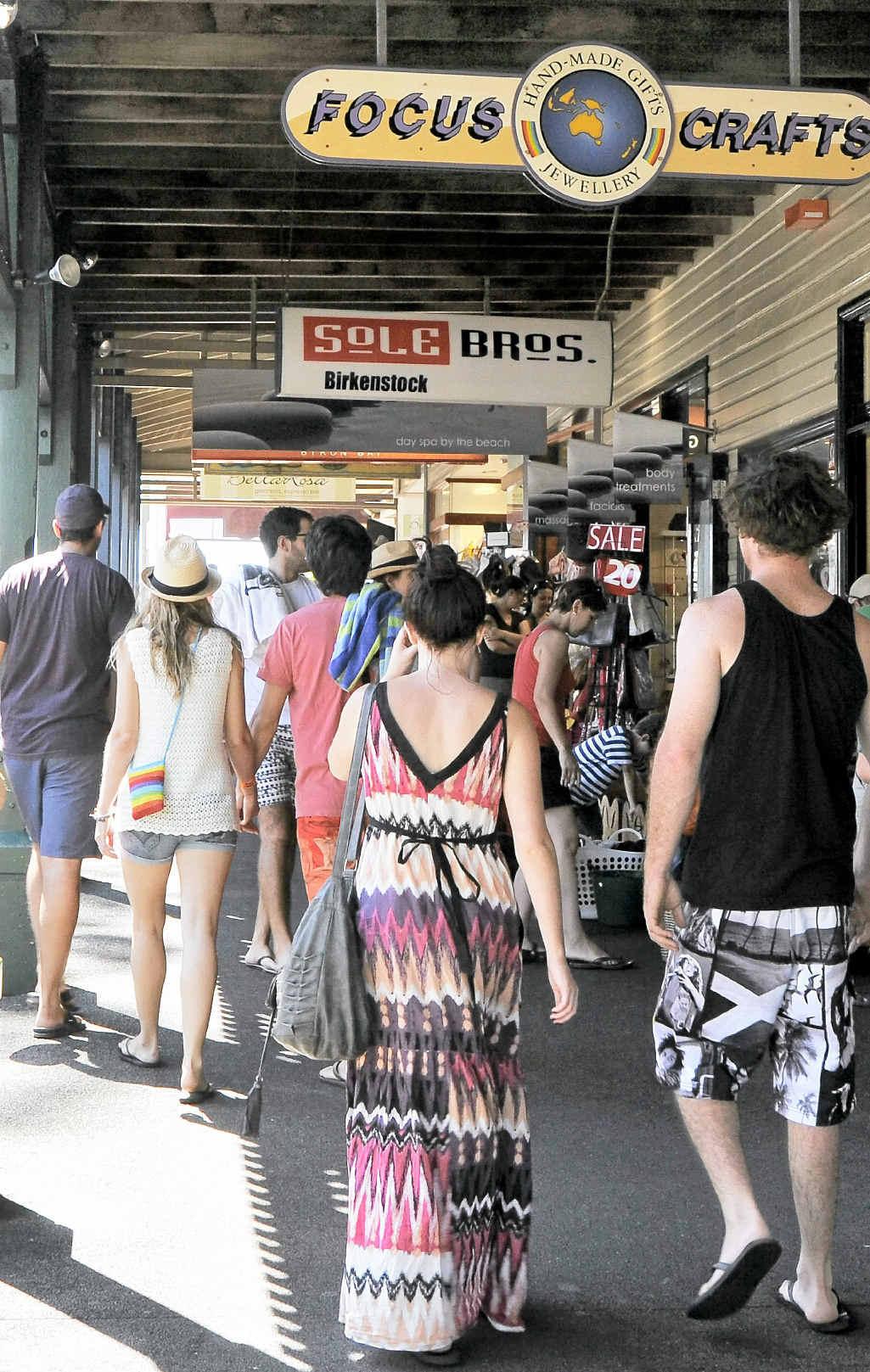 Shoppers stroll through Byron yesterday.