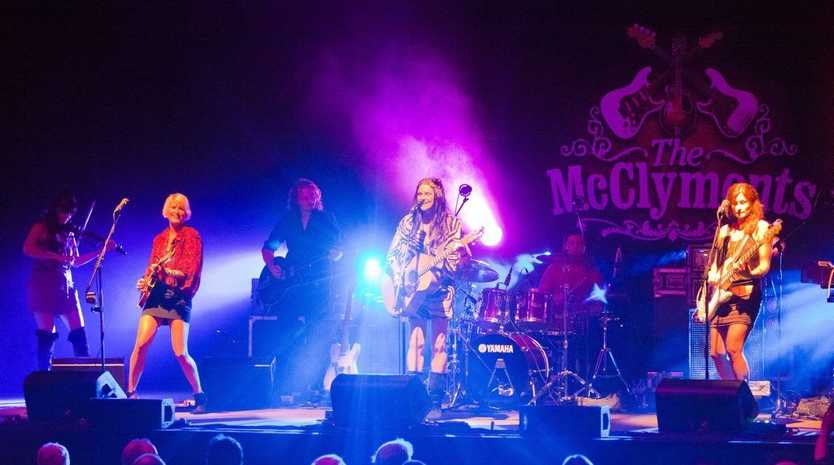Mollie, Brooke and Sam McClymont perform on stage at their performance at the Saraton Theatre.