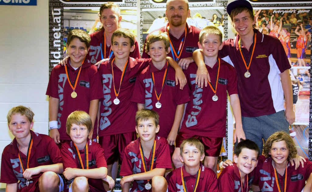 The Bundaberg under-12 Bulls with their silver medals at the state championships: Luke Wilson (front left), Aubyn Turnbull, Brennan Norris, Jayden Buchanan, Lucas Duncan, Khobi Redgard, Sepehr Mahjoub (middle left), Mitchell Wright, Kyle Spann, Kaleb Bax, manager Andrea Bax (back left), coach Sean Mullaney and assistant coach Shayne Mayes.