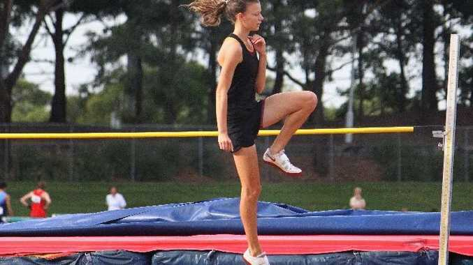 Nationally identified high jumper Cassie Purdon goes through her warm-up drills before competing in her recent Australian championships event in Sydney.