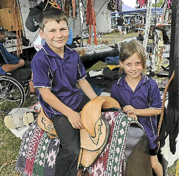 Cody and Cassie Lentas test ride Burrum River Saddlery's products at the AgroTrend field day.