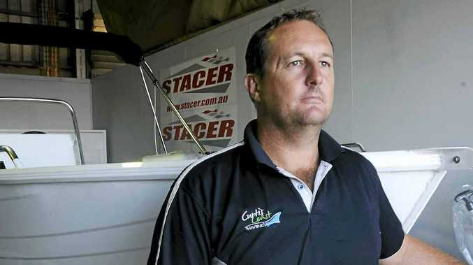Curtis Coast Marine part-owner Darren Browne says he is having to work harder than ever in his business and has thought about selling up.