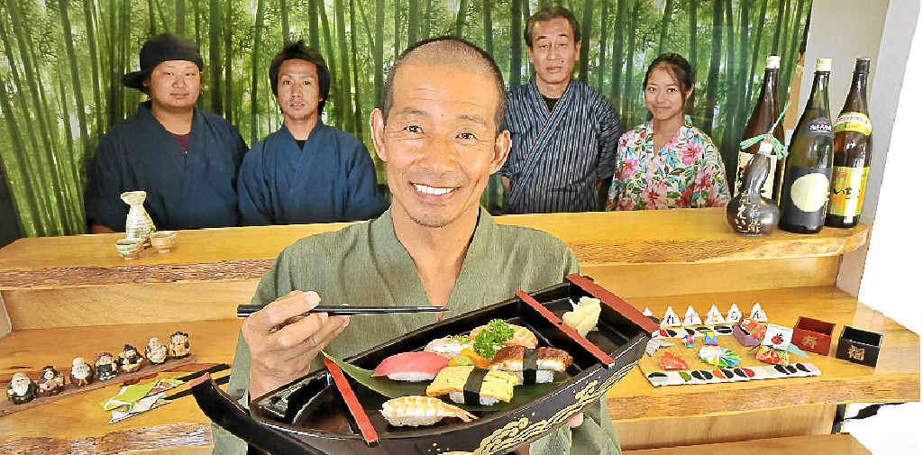 PROMOTING HEALTH: Dicky Beach's Yume Japanese Restaurant owner Genta Tsukimori, with staff members, from left, Ryu, Naoki, Shiro and Maiko.