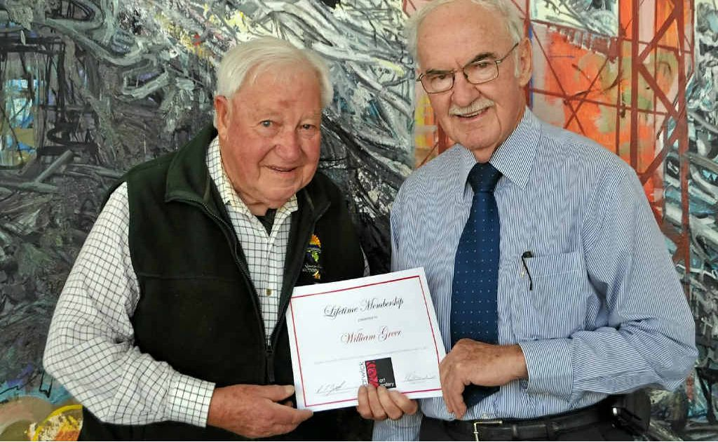 Mayor Ron Bellingham (right) presents Bill Greer with a lifetime membership to the Warwick Art Gallery for his 12 years of volunteer service.