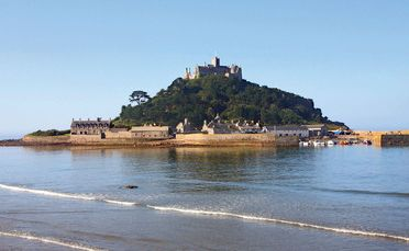 St Michael's Mount in Cornwall, originally a coastal hill, now lies nearly 400m offshore from the village of Marazion.