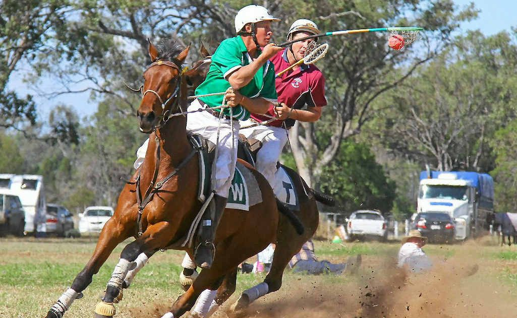 Queensland captain and Warwick 1 player Paul McGrath (with ball) on the way to an A-grade state championship victory with the Warwick polocrosse club.