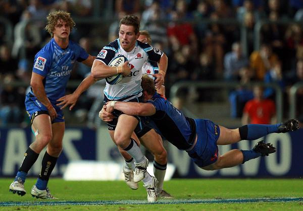Bernard Foley of the Waratahs attempts to break from a tackle by David Pocock of the Force during the round seven Super Rugby match between the Force and the Waratahs.