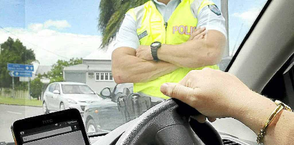 Texting while driving attracts a $300 fine in Queensland.