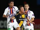 Michael McGlinchey of the Marinersis tackled by Jacob Burns of the Glory during the A-League Grand Final Qualifier match at Bluetongue Stadium.