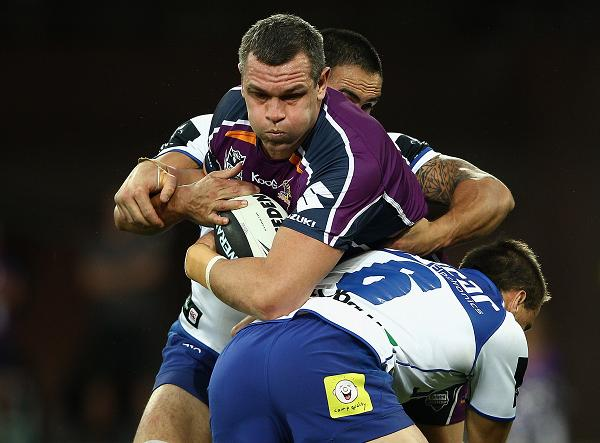 Jason Ryles of the Storm is tackled by Josh Reynolds of the Bulldogs during the round seven NRL match between the Melbourne Storm and the Canterbury Bulldogs at AAMI Park