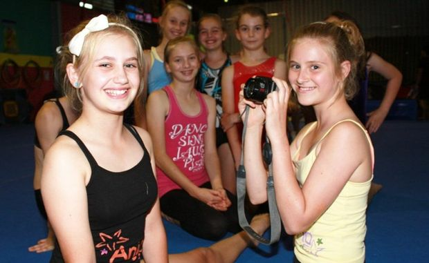 Potential future Olympic gymnasts Anjo Van Heerden (front left) and Karma-Lace Ward limber up for the Heritage Acquisitive Photographic Awards watched by fellow gymnasts (from left) Hannah Emmert, Laura Cheek, Elijsha Davey and Emily O'Rourke at the Allstar Gymnastics Academy in Toowoomba.