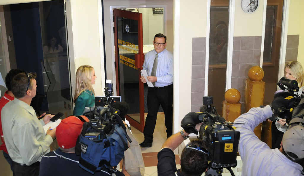 David Gibson emerges from his office to address reporters in Gympie yesterday.