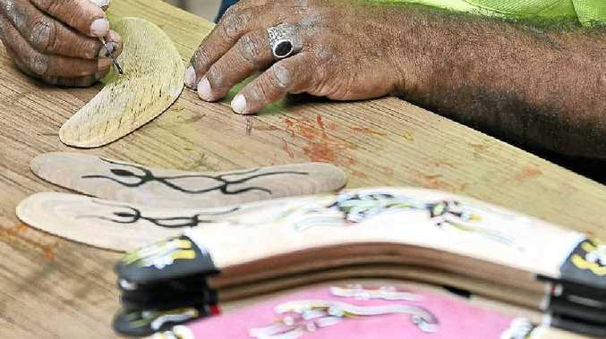 In Kyogle, Wayne Walker is making boomerangs.