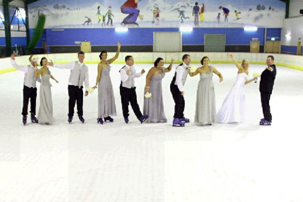 Tamworth couple and their bridal party take wedding pics on ice at the Big Banana Ice Rink.
