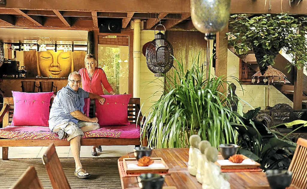 Kim and Jill Robinson relax in their award-winning setting. The couple's garden won its category in House & Garden magazine's Garden of the Year awards.