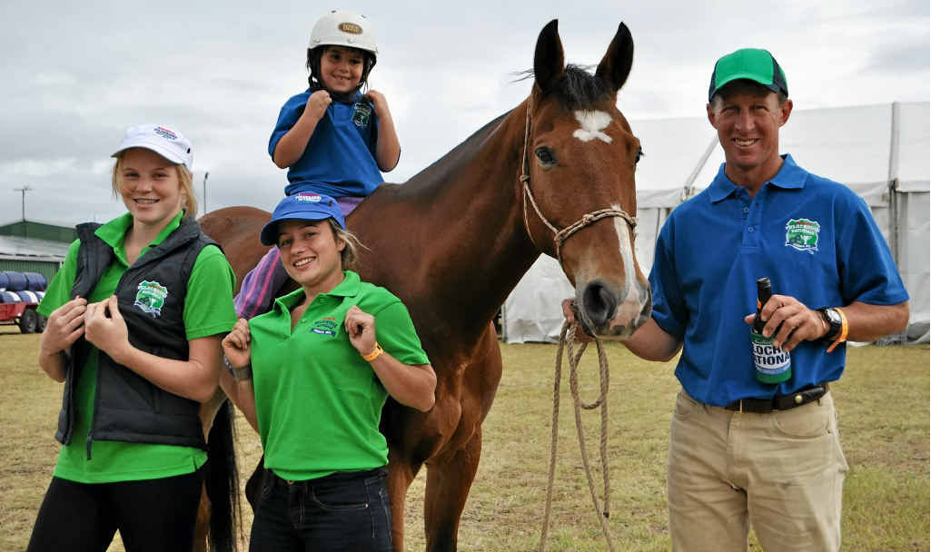 Bec McMurray, Sandy Corbert, Georgie Hopkins, on Dingo, and Paul McGrath flaunt the swanky polocrosse merchandise supplied by the region's businesses.