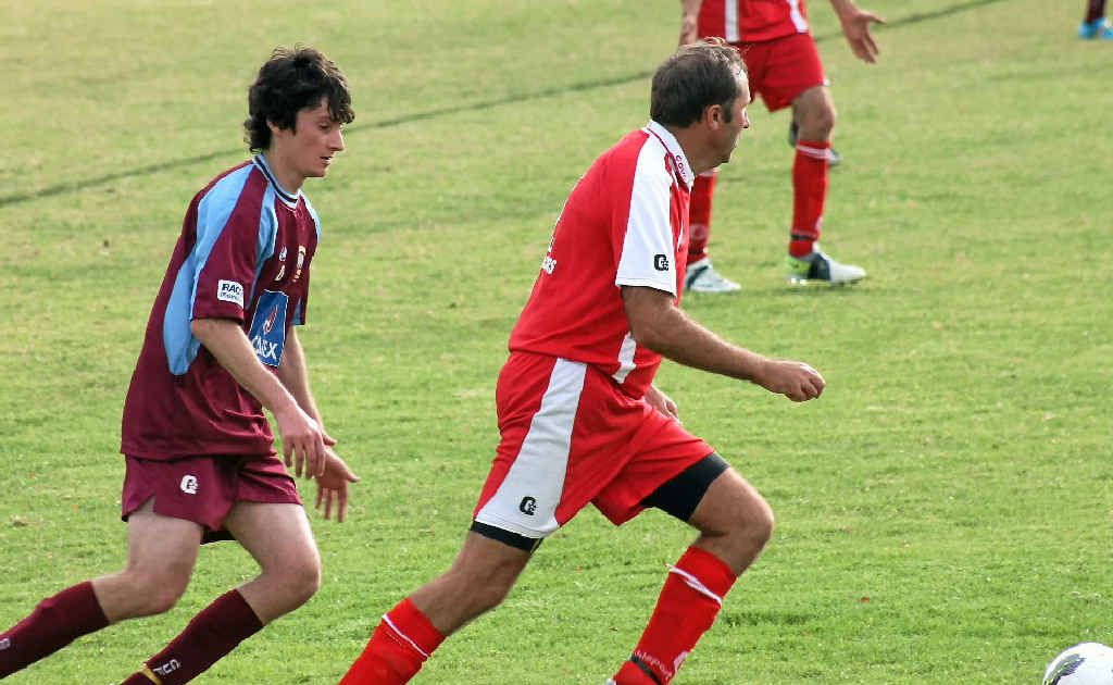 RUN: Chris Visentin chases down Neil Newman. The 2012 Stanthorpe football season hits round two this weekend.