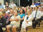 Candidates for divisions 5-10 at the Hervey Bay Community Centre. The audience listens to the speakers.