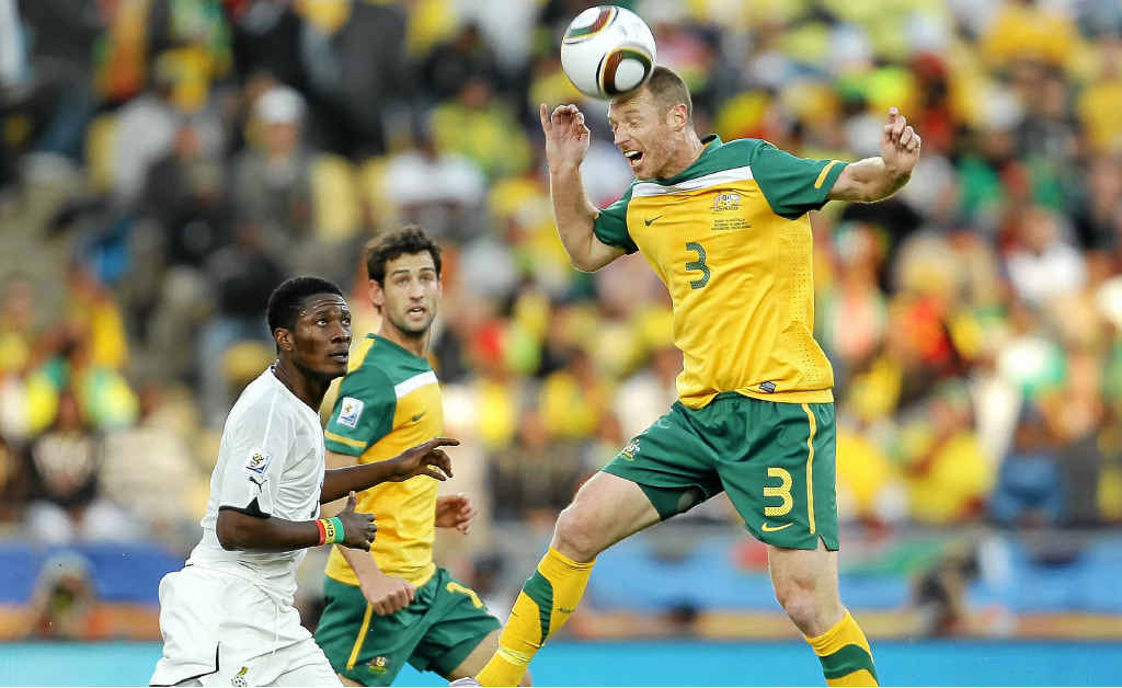Socceroo Craig Moore, who will be in Lismore next month, goes up for a header during the 2010 FIFA World Cup in South Africa against Ghana.