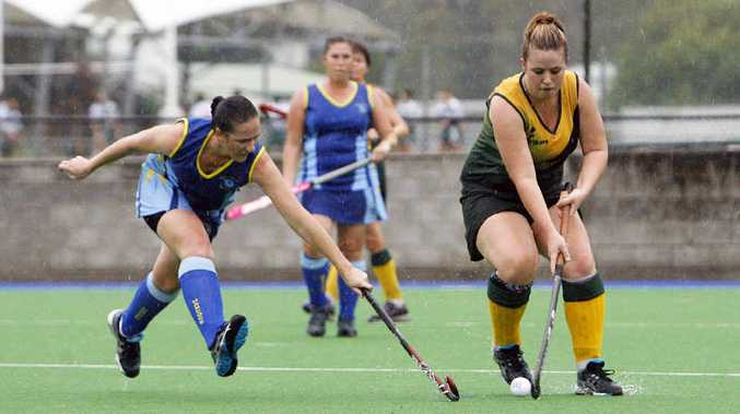 Reliable Hancocks player Justine Parkes (left) closes on a Bellbowrie player during their recent A-grade hockey match at Raceview.